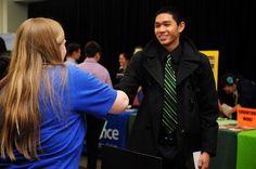 Shaking hands at the Career & Internship Fair