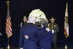 Arm in arm: A couple pause as they pay their respects beside the casket of Nancy Reagan at the Ronald Reagan Presidential Library