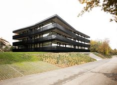 apartment building by FHV floats with concentric, rectangular rings