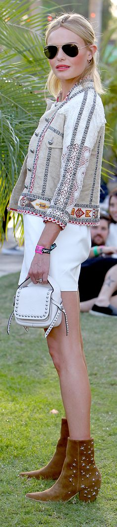 Kate Bosworth carrying a Coach leather bag at Coachella.