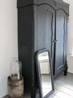 Black antique wardrobe, black framed mirror against pure white walls. A bedroom combining both Victorian and modern styles Furniture, Furniture Near Me, Interior, Home Furniture, House Styles, Painting Wooden Furniture, Bedroom Armoire, Rustic Interiors, Black Furniture