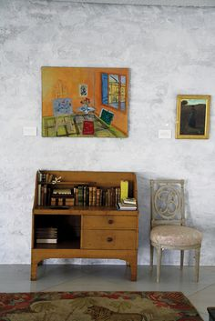 "A Raoul Dufy above a Shaker wash stand and a ""B"" for ""Bunny"" chair in the home of late heiress and horticulturalist Bunny Mellon. Photo by Charlotte Moss."
