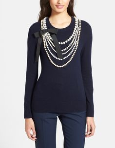 Love the faux pearl necklace on this Kate Spade sweater.