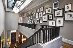 The staircase is a classical area for displaying family photos. That's because it's a space where you can't use many other types of decorations. A large collection of family photos would look beautiful if you use the same type of frames but with different sizes.