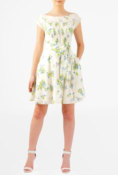 Sweet floral print cotton with pintuck pleat front and lace trim adds fresh energy to our fit-and-flare dress cinched in with a waist-defining removable sash tie belt.