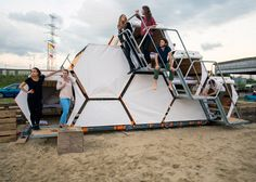 Modular honeycomb of wooden sleeping cells designed for festivals