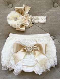A personal favorite from my Etsy shop https://www.etsy.com/listing/266252391/ivory-and-gold-lace-ruffled-baby