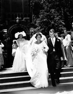 Newlyweds Ethel Skakel and Robert F. Kennedy leave St. Mary\'s Roman Catholic church in Greenwich, Ct. on June 17, 1950. After a wedding reception at the Skakel\'s home, the couple will depart for a 3-month trip to Hawaii.