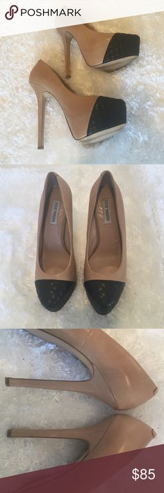 GORGEOUS nude platform pump with black quilted toe In used but nearly new condition. Right pump has very, very light spots on right side of nude leather; maybe slight water spot or natural variation in hide. Steve Madden Shoes Heels