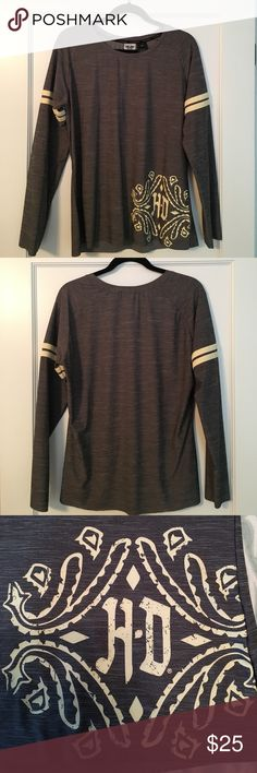 NWOT H-D Performance Long Sleeve Shirt Harley Davidson gray performance long sleeve shirt with yellow stripes on sleeves & beautiful yellow decal on shirt. Material is stretched and is light, perfect layer for riding! Harley-Davidson Tops Tees - Long Sleeve