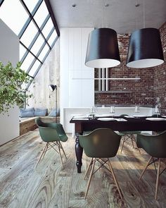 Love the steel windows and brick walls in this open loft.  Kitchen and dining area.