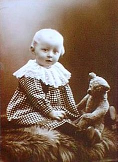 vintage photo- child with teddy bear
