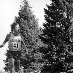 Black and white photo of University of Oregon cross-country runner Steve Prefontaine on his way to victory in PAC-8 Cross Country Championship held at the Washington State University golf course on November 14, 1970 in Pullman, Washington. ©University of Oregon Libraries - Special Collections and University Archives