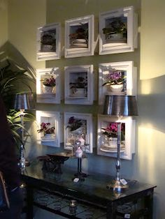 Love the idea of using teacups in shadow boxes with African Violets as a display wall...