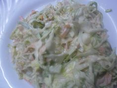 COLE SLAW  A salad for any season. INGREDIENTS - Sweet cabbage, - 2 carrots, - Salt, - Pepper, - Mayonnaise, - Freshly squeezed lemon juice. Cut the cabbage with electrical cutting machine, with a grater or simply with a knife. Clean and wash the carrots and give the grater with large holes. Cabbage is mixed with grated carrots, place a spoonful of sugar and salt and rub well. Add pepper, a tablespoon freshly squeezed lemon juice and mayonnaise.