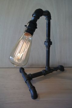 sick lamp    http://www.etsy.com/listing/99906942/ironpipelight-industrial-table-lamp