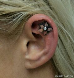 Tattoo and accent piercing... I want something like this or surface piercings on my tattoo!!