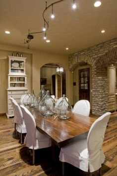In this country-cute dining room, a set of rounded-back dining chairs have slipcovers with short casings. Short casings are a playful way to change up your dining room without having to change the furniture.
