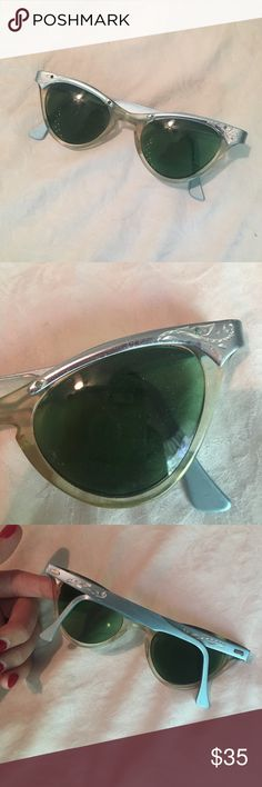 Light blue sunglasses vintage 50s style cateye Price drop!!! Cute pale pastel blue 50s style cat eye vintage prescription sunglasses! These sunglasses feature green cat eye lenses in a plastic frame, with blue metal across the top and blue metal arms. If worn, the lenses will need to be replaced as they are prescription (bifocals). In very good vintage condition, showing minor, age-appropriate wear. Circa 1950s Vintage Accessories Sunglasses