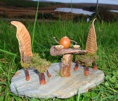 fairy furniture / milk weed pods....love the pine cone petals used for legs on the chairs....