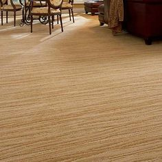Undulating surface textures create elegance and excitement in an organic horizontal ripple effect. Surge, a flowing, cut and loop pattern, combines silky softness of hand with superior performance. Made with 100% INVISTA Tactesse® BCF type 6,6 nylon, it is available in twenty-six fashion forward colors.
