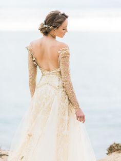 25 Whimsical Wedding Dresses for Artistic Brides i love this dress so much! i wonder what the front looks like