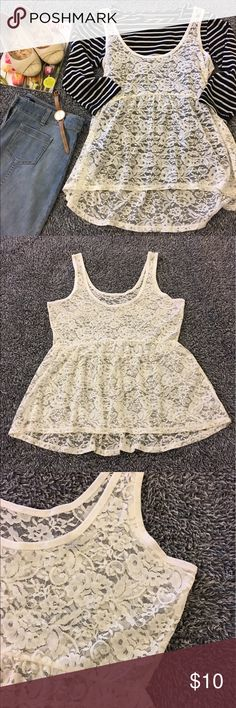 Adorable lace, layering tank - perfect for spring I didn't wear this piece a lot but some how I managed to put a few small holes in the lace. They are not real noticeable tho due to the pattern of the fabric and the fact that lace has intentional holes lol. Good shape otherwise & SF! C pics for details/condition! Super cute for layering and can be dressed up or down. Back is longer then the front. Bust is 18.5 flat. Waist is 16.5 plus stretch. Hips are 26. Length is 25.5/27 front/back…