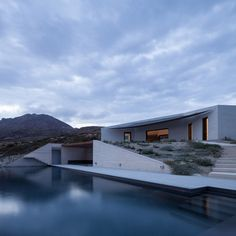 This ridged limestone house by Athens studio decaArchitecture faces out over the edge of a cliff on the Greek island of Milos.