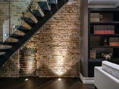 brick wall + floor lighting