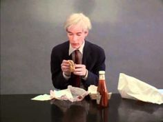 Andy Warhol eating a hamburger, The scene is part of a film done by Jorgen Leth called 66 scenes from america