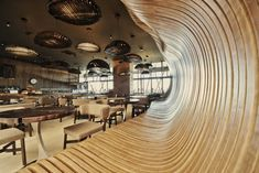 The Don Cafe House, Pristina, Kosovo: 1 The walls of the café are shaped to mimic the curves of a giant sack containing coffee beans inside. Both the color and the contours of the large wall made up of wood help accentuate this affect, while the decor and the furnishings play their part to perfection.