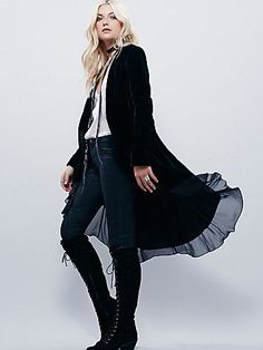 Swingy Velvet Jacket | Swingy velvet jacket with high-low ruffle hem and long sleeves. Delicate chiffon lining that peeks out the bottom. Hip pockets.