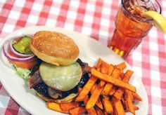 Sweet potato fries are a nice compliment to a Sal & Mookie's Swiss Cheese and Bacon Burger.