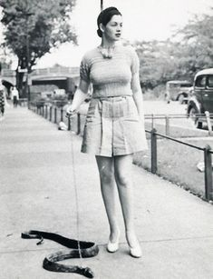 She takes a walk with her snake
