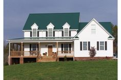 colonial farmhouse with wrap around porch on a hillside lot - Google Search