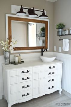 Expansive Mirror Optically Enlarges Space.  Actually, I pinned this as a visual for the colors of the finishes in this bathroom.