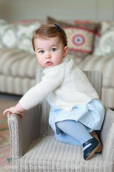 Little Princess Charlotte at 11 months of age, in her Amner Hall home. Such cuteness. This picture captures her curiosity - in the motion of climbing on to her one wee wicker chair.