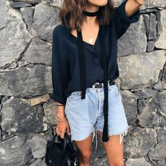 Ultimate casual cool. Silky blouse, skinny scarf, and boyfriend cutoffs cinched with a dressy leather belt.
