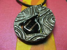 The other side of the faux metal pendant design