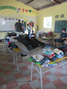 Sponsorship Awareness Brigade 2012:  The brigaders set up donated clothing and gave an outfit to each of the students and their family members in one of the mountain communities!