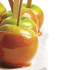 fall party idea: caramel apple bar, including peanuts, almonds, sprinkles, choco chips, . . .