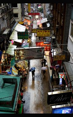 "Soho - Hong Kong    This is the quater called ""SoHo"" in Hong Kong. It is ethnical very inhomogeneous, so you can find a creolic kitchen near to an italian shoe designer in a mainly tai owned street, and that's the reason why this place is so interesting. In this picture you can see the small shops all around, the food is always fresh and delicious."