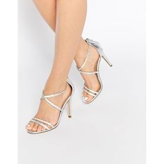 ALDO Arenani Silver Cross Front Heeled Sandals ($51) ❤ liked on Polyvore featuring shoes, sandals, silver, aldo shoes, metallic sandals, silver strappy sandals, high heel sandals and strap heel sandals