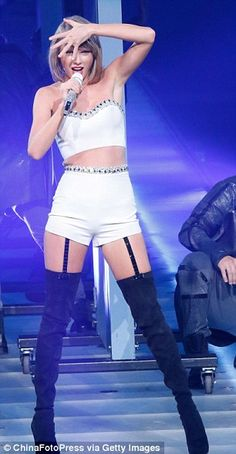 Bringing sexy back: The former country singer slipped into a pair of thigh-high boots which featured suspender attachments