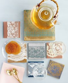 I'd love to make a mosaic with these! Just ceramic tiles, lace, and spraypaint