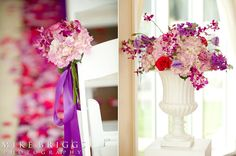 Aisle bouquet and altar urn with roses and orchid sprays.  (Design by Lee Forrest Design, photo by: Mike Briggs Photography)