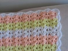 Free crochet pattern for Double Shell afghan. This would be cute in rainbow colors or pastels.