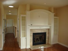 fireplace surround custom made by Top Notch Carpentry Inc. Fireplace Molding, Fireplace Bookcase, Granite Fireplace, Custom Fireplace, Rustic Fireplaces, Home Fireplace, Fireplace Surrounds, Fireplace Ideas, Hearth And Home
