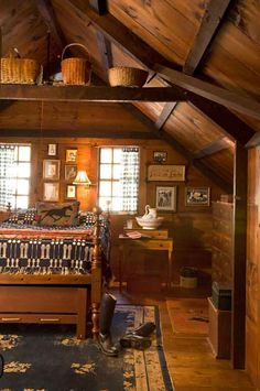 Rustic Country Bedroom...love the wood on the walls & the prim baskets on the beams.