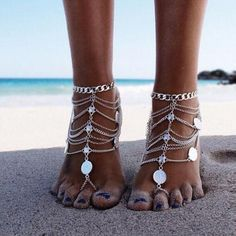 Adorn your feet with this over the top, coin and multi-chain silver tone foot jewelry. Perfect jewelry wear for your next beach vacation or Hula Party. Fits comfortably about the middle toe and lays a